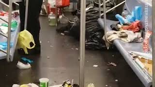Man enjoys lovely morning ride in trash-covered NYC subway train