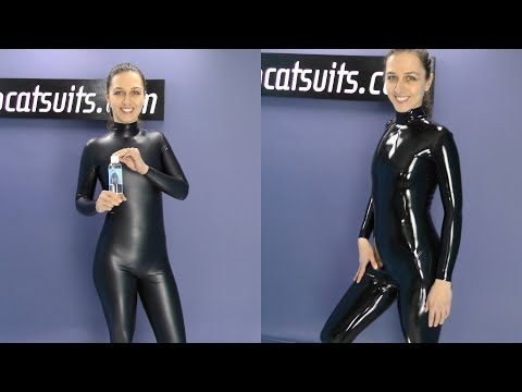 Polishing herself in latex catsuit