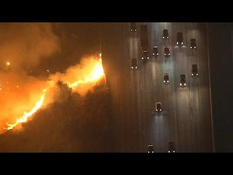 Alarming video shows wildfire right next to major California highway