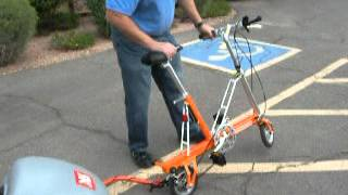 CarryMe compact folding bike with Ride Kick! Thumbnail