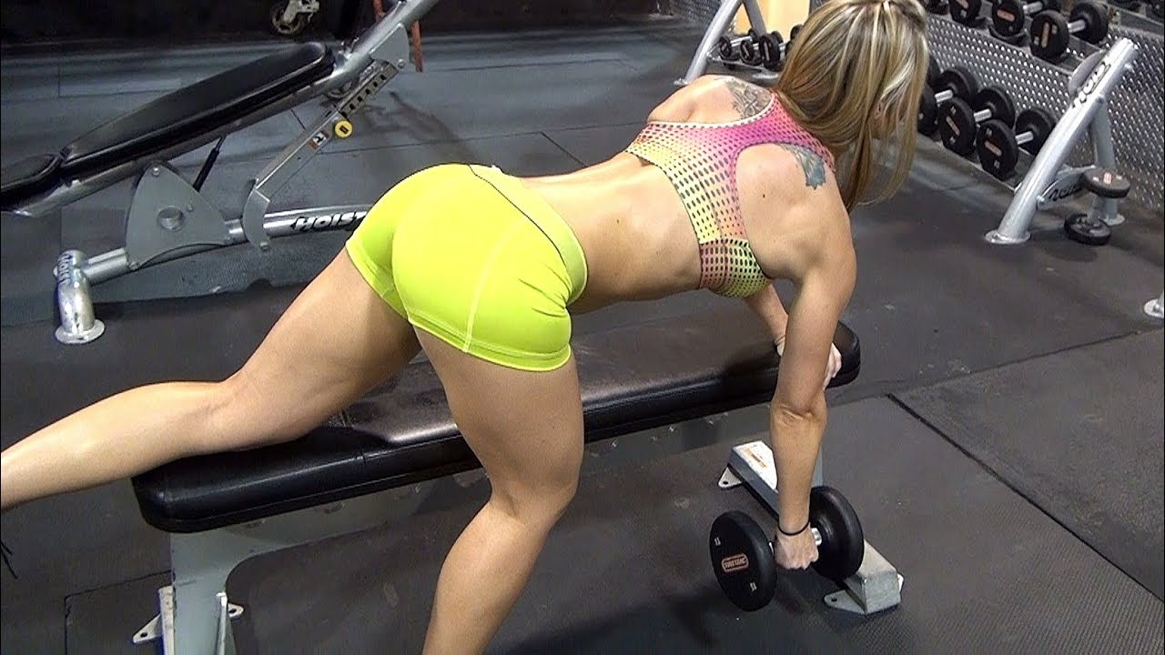 Female Fitness Models Arms, Abs, and Back Exercise. Dumbbell Rows ...