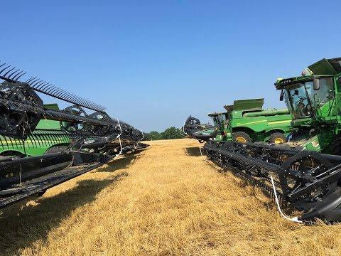 8 John Deere S690 Combines Harvesting Wheat
