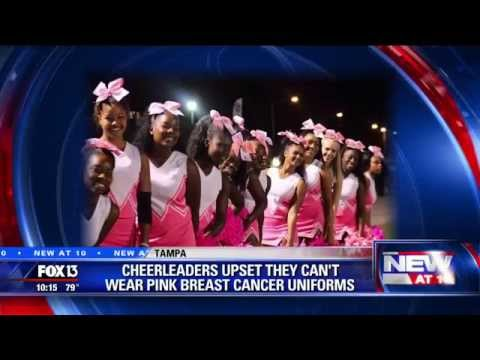 Cheerleaders upset they can't wear pink uniforms