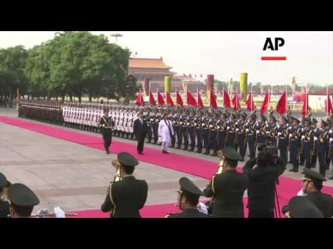 President Rajapaksa welcomed by counterpart Xi, meeting