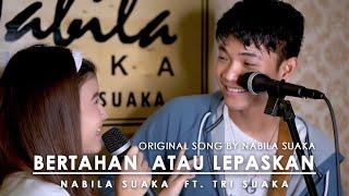 Download Mp3 Bertahan Atau Lepaskan - Nabila  Lirik  By Nabila Suaka Ft. Tri Suaka