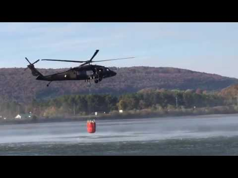 Blackhawk helicopter pulls water from lake to fight wildfires