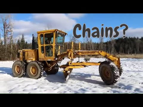Snow Plowing With A Caterpillar Road Grader