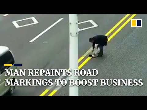 Man repaints road markings to attract customers to restaurant