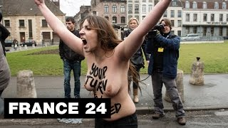 FRANCE - Topless FEMEN protesters target former IMF director Strauss-Kahn at pimping trial