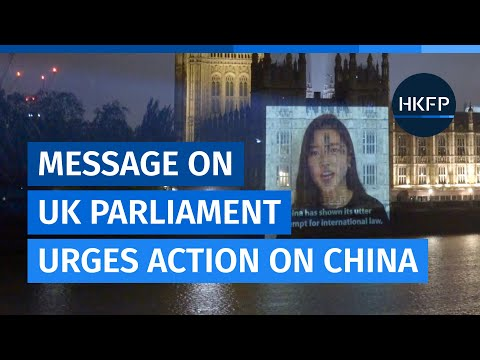 Activists project message onto UK parliament urging China sanctions over Tibet, Xinjiang & HK