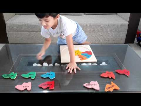 """Moksh Plays With """"The Twelve Months Of The Year"""" Montessori Wooden ..."""