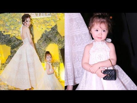 Con gái  Elly Trần điệu đà đeo túi hàng hiệu diện váy trắng trong tiệc sinh nhật 2 tuổi