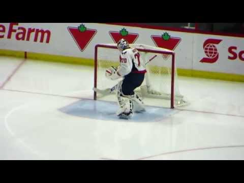 Braden Holtby warms up during the Capitals @ Senators hockey game
