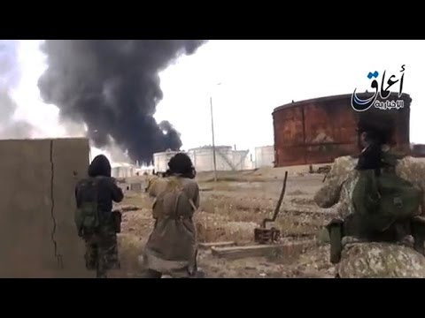 ISIS fights to take Iraqi city and largest oil refinery