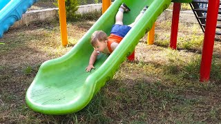 One years old baby upside down on the slider - Funny Babies 2020