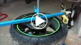 Motorcycle rear tire change with homemade tools