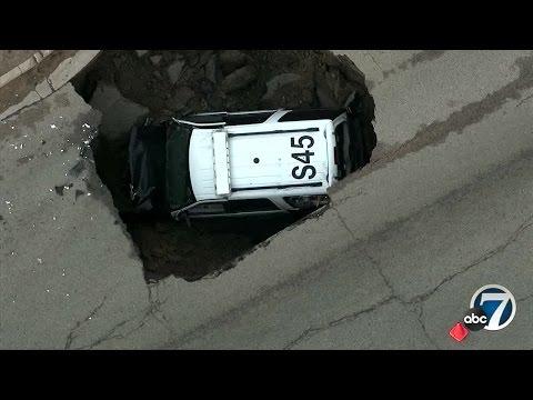 Colo. cop's SUV falls into sinkhole