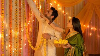 Indian married couple decorating the house with garlands - Festival celebration and preparation