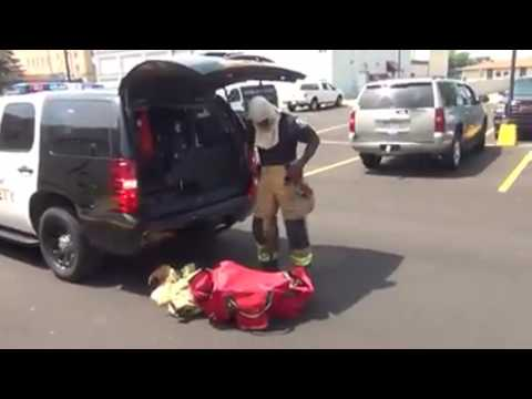 bay-city-public-safety-officer-demonstrates-transition-from-police-to-firefighting-gear