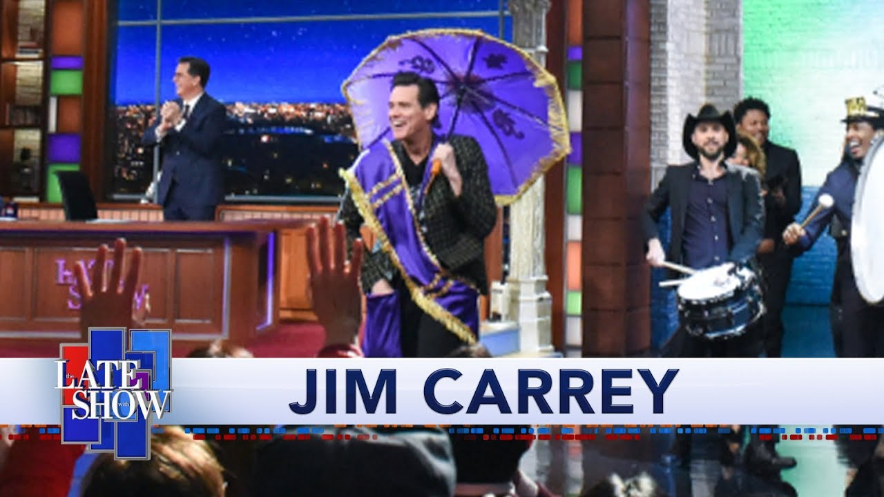 Watch Jim Carrey Make 'Colbert' Entrance With Jon Batiste & Stay ...