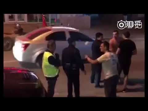 Foreigners  mess with Chinese police and be subdued