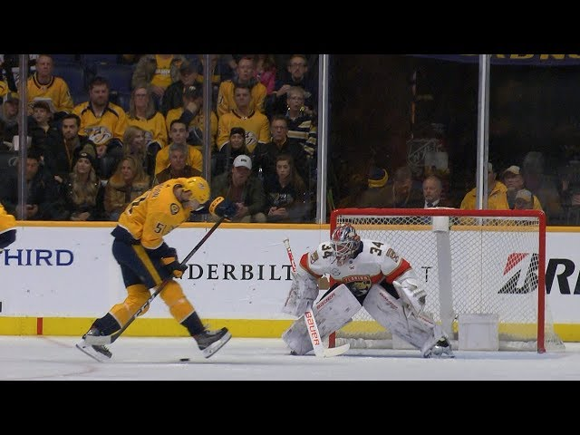 Austin Watson strikes with nifty between-the-legs redirect