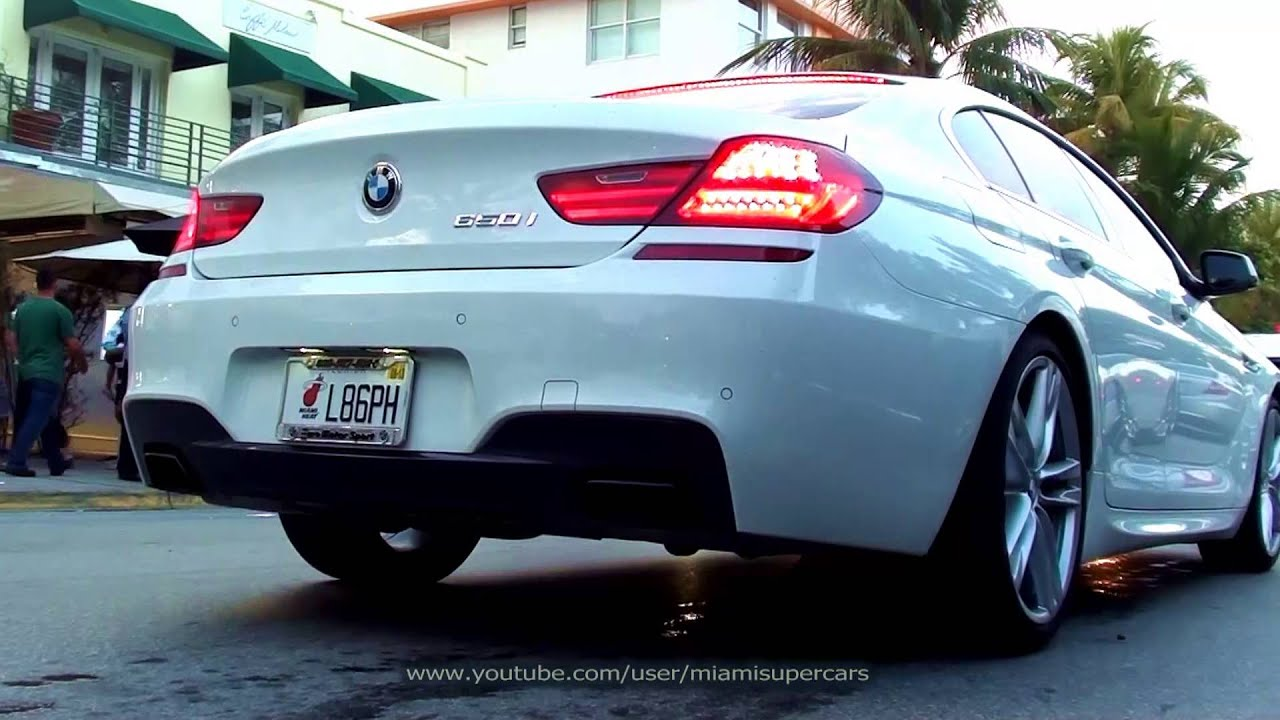 Beautiful White BMW 650i Gran Coupe driving on Ocean Drive in Miami