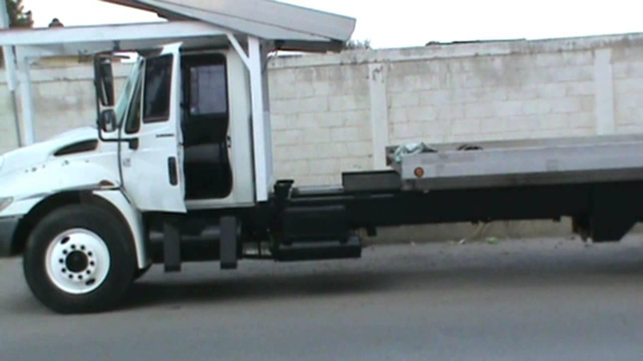 en venta camión internacional con plataforma deslizable grúa