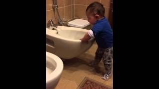 Baby Yousef messing in the toilette
