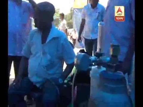This State Bank employee embarks on poll-duty with oxygen cylinder