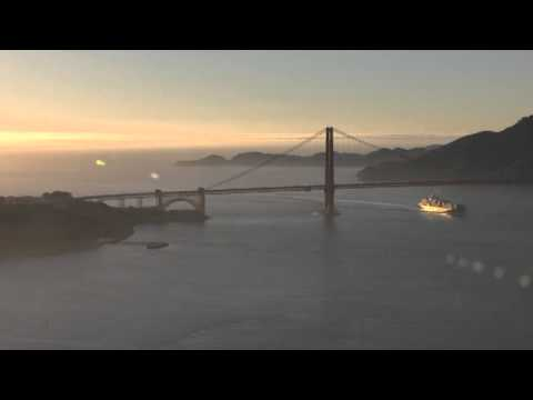 Golden Gate Bridge Helicopter Aerial Video View of Cargo Ship sailing into San Francisco Bay