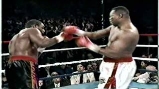 Oliver McCall vs Larry Holmes (highlights)