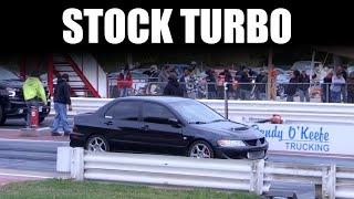 Mitsubishi EVO runs 11.9 @ 121 on a stock evo9 turbo