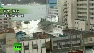 Fresh footage of huge tsunami waves smashing town in Japan thumbnail