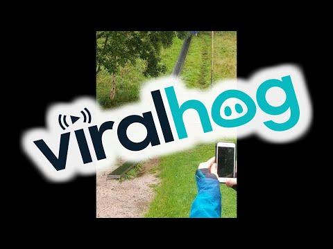 Rain Makes Steel Slide Extra Slippery || ViralHog