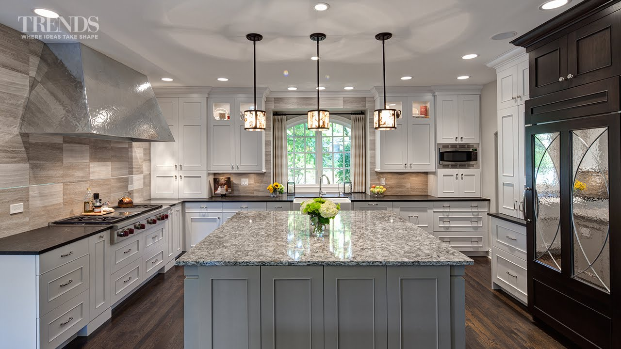 Large transitional kitchen design has two islands and a mix of white ...