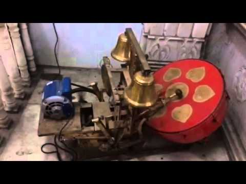 Temple Aarti with machine Ghanta and Nagara running by ele