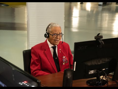 David Paddock speaks with Brigadier General McGee, original member of the Tuskegee Airmen