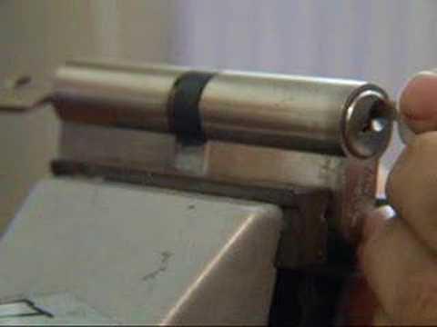 Lock picking EURO cylinder with key inserted.