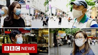 Hong Kong residents respond to controversial security law - BBC News