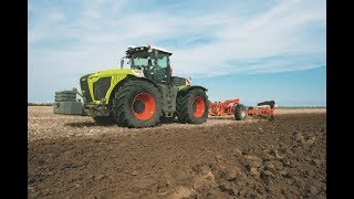 Claas Xerion 5000 at Wet Soil