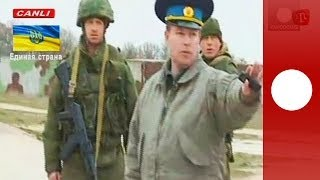 Repeat youtube video Video: Russian troops fire warning shots as Ukrainian military march towards Crimea air base