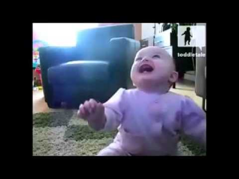 Baby Girl Laughing Hysterically At Dog Eating Popcorn