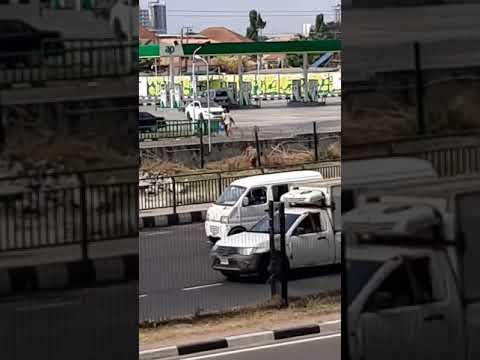 Lady Carries Her Boyfriend On The Back To Cross A Busy Road