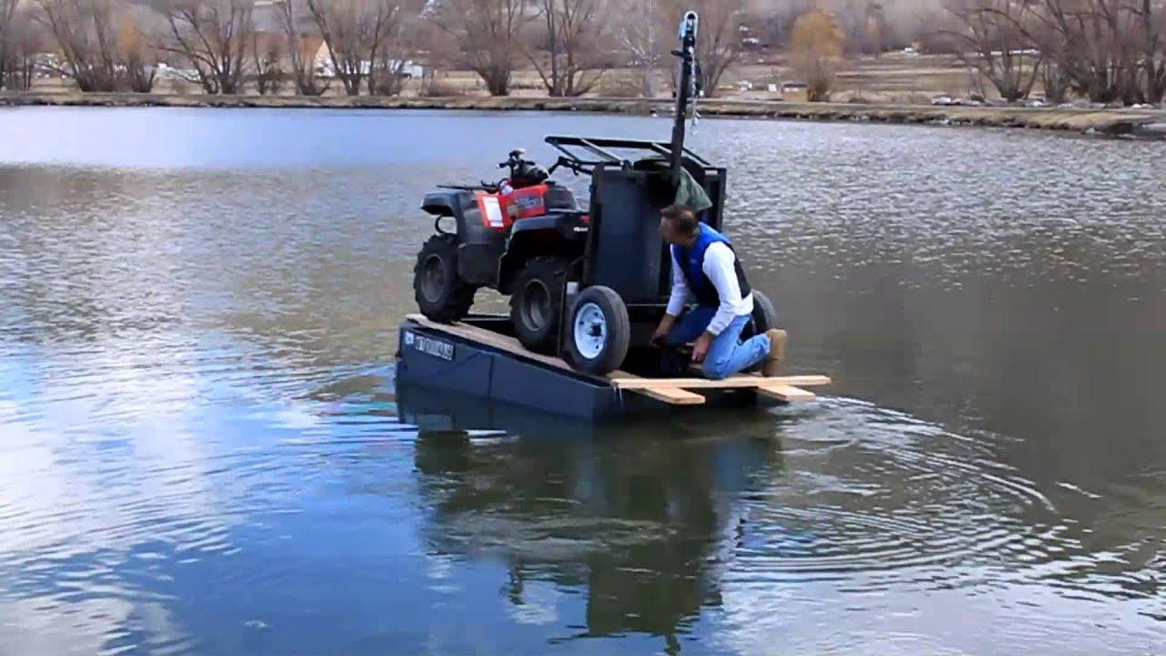 ATV floats on small boat