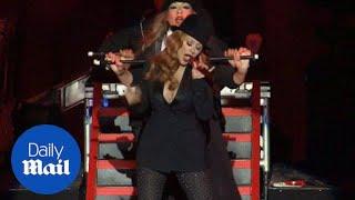 Christina Aguilera debuts a new red dye job at benefit concert - Daily Mail