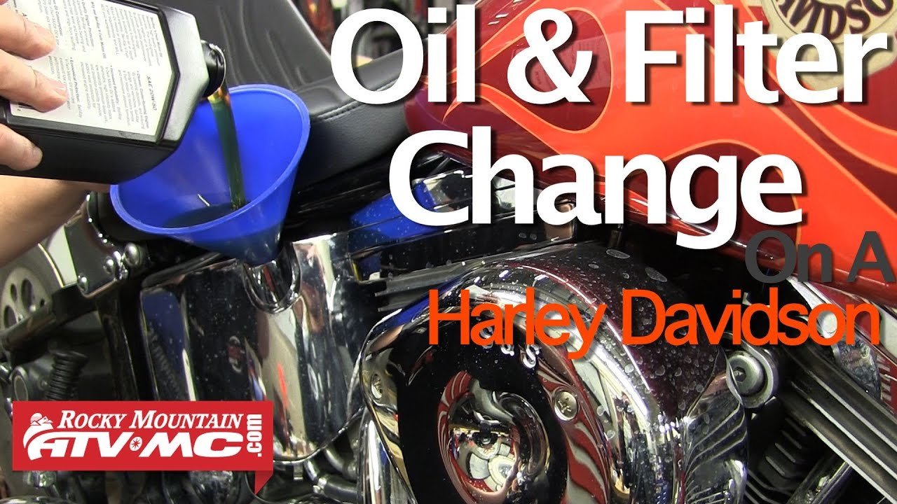 What are the steps in changing the oil on a Harley-Davidson?