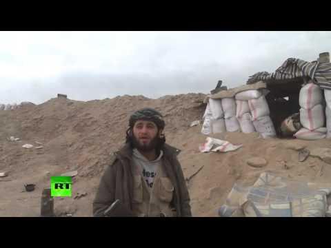 Al Nusra commander & reporter hit by mortar fire filming interview