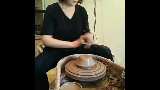Rachel throwing a serving bowl