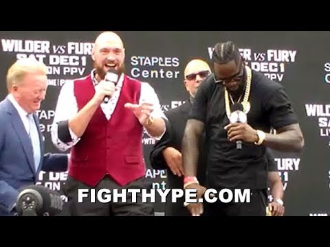 TYSON FURY STEALS DEONTAY WILDER'S THUNDER; TRADES VERBAL LASHINGS UNTIL WILDER'S MIC CUTS OFF